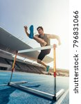runner jumping over an hurdle... | Shutterstock . vector #796831066