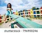 little latin girl playing on... | Shutterstock . vector #796900246