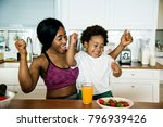 mother and son eating healthy... | Shutterstock . vector #796939426
