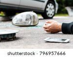 Small photo of Close-up of hand of a careless driver involved in an incident after using a phone while driving