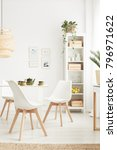 simple  white chairs at the... | Shutterstock . vector #796971622