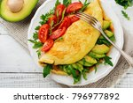 omelette with avocado  tomatoes ... | Shutterstock . vector #796977892