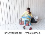 young traveler sitting on a... | Shutterstock . vector #796983916