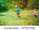 happy little boy and girl run...   Shutterstock . vector #797017996