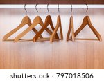 wooden coat hangers on clothes... | Shutterstock . vector #797018506