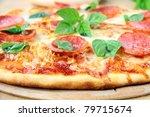 Fresh hot pepperoni pizza - closeup - stock photo