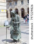 Small photo of WROCLAW - POLAND, JUNE 13, 2017 : The Monument of An Anonymous Passerby, Transition, sculptures of people by Jerzy Kalina. Installation located at the intersection of streets in the city since 2005