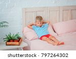 the boy is lying on the bed  ... | Shutterstock . vector #797264302
