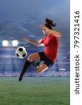 female soccer player performing ... | Shutterstock . vector #797321416