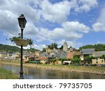 View at the medieval village of Montignac , at the foreground the Vezere river. - stock photo