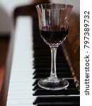 glass of red wine and piano | Shutterstock . vector #797389732