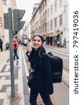 Small photo of Female traveler woman sightseeing in European capital.Visitor in Lisbon,Portugal.Iconic tram route.Traveling Europe on a budget.Studying abroad.Photography and travel concept