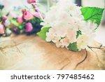 flowers on wooden background... | Shutterstock . vector #797485462