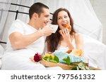 couple having breakfast in bed | Shutterstock . vector #797561332