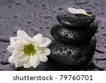 black balanced stones and flower - stock photo