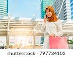 young muslim asian woman hand... | Shutterstock . vector #797734102