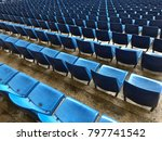 Small photo of Blue Seat rows in football stadium - empty seats in arena