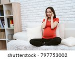 a pregnant girl feels pain.... | Shutterstock . vector #797753002