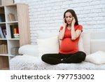 a pregnant girl feels pain. her ... | Shutterstock . vector #797753002