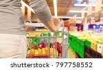 woman with shopping cart in... | Shutterstock . vector #797758552