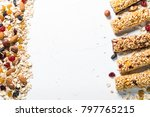 Stock photo granola bar and ingredients healthy sweet dessert snack cereal granola bar with nuts fruit and 797765215