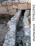 Small photo of The remains of antique sewage in the city of ancient Patara, mugla Province, Turkey.