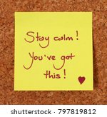 Small photo of Yellow sticky note on a cork board background, saying stay calm, you've got this.