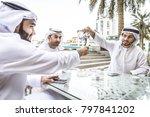 three arabic men bonding... | Shutterstock . vector #797841202