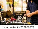 hands of car mechanic in auto... | Shutterstock . vector #797853772