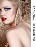 Small photo of beautiful blond with hair in upstyle wearing dark fashion eyeshadow and red lips looking over shoulder on gold background in sepia fashion effect