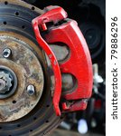 Rusted disc brake and caliper on car - stock photo