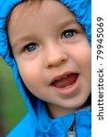 baby in a raincoat | Shutterstock . vector #79945069