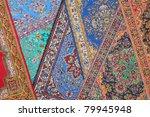 Seven Varicolored Carpets Lie...