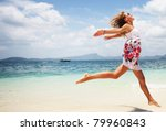 Woman In Summer Dress Jumping...