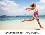 Woman In Summer Dress Jumping...