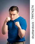 This is a photograph of a young man standing in a boxing position - stock photo