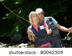 Couple Fly Fishing In River...