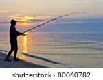 The Siluette Of Single Fisherman