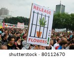 WARSAW - MAY 28: Participants of rally for cannabis soft drugs (marihuana) legalization on May 28, 2011 in Warsaw, Poland. Rally was organized by the Free Hemp Initiative and gathered 6000 people. - stock photo