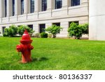 A Red Fire Hydrant In A City...