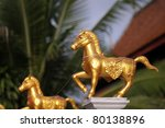 Golden horses sculpture of temple - stock photo