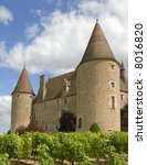 The castle of Corcelles in France and its vineyard. - stock photo