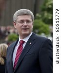 OTTAWA, ONTARIO, CANADA - JUNE 30: Prime Minister Stephen Harper greets the crowd while waiting for the Duke and Duchess of Cambridge to arrive.on June 30, 2011 in Ottawa, Ontario, Canada. - stock photo