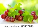 Bunch of grapes  on green background - stock photo