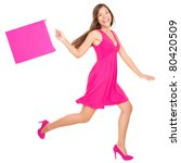 Happy shopping woman in pink running with shopping bags. Isolated on white background in full length. - stock photo