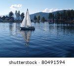 Sailboat Sailing On A Blue...