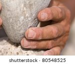 Rock and Mason's hands - stock photo
