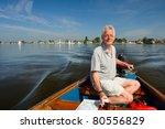 Elderly Man Is In Motorboat At...