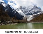 Snow mountain and lake in Daocheng,Sichuan Province, China - stock photo