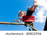 Little Girl Child Sitting On A...